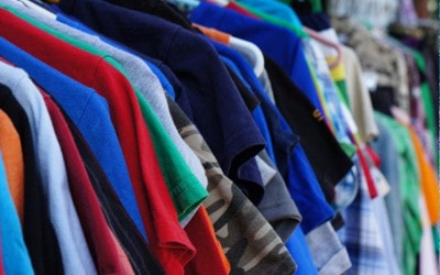Colorful T-Shirts Hanging in Street Store